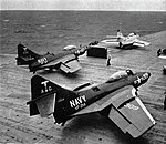 Grumman F9F-8 Cougars of VF-214 and VF-94 are launched from USS Yorktown (CVA-10), in 1956.jpg