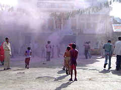 Gulal clouds as children play Holi at Pushkar, Rajasthan.jpg