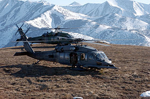 HH-60 Pavehawk helicopters on a mountain in Alaska.jpg