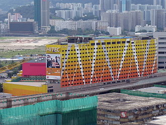 Kowloonbay International Trade & Exhibition Centre - KITEC, with the site of the former Kai Tak Airport in the background