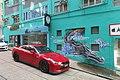 HK 上環 Sheung Wan Upper Station Street sidewalk carpark GT Red car 荷李活大樓 Hollywood Building green wall graffiti dragon July 2018 IX2.jpg