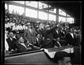 Herbert Hoover throwing baseball from stands at stadium LCCN2016889414.jpg