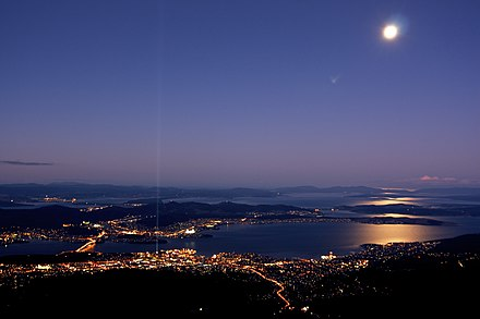 The city of Hobart, seen here from Mount Wellington, is Tasmania's most populous city and comprises a large portion of the state's population. Hobart moonrise from Mt Wellington.jpg