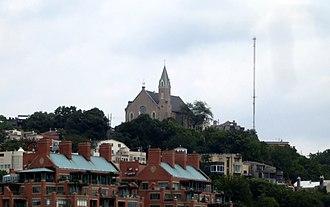 Immaculata Church - Holy Cross-Immaculata Church sitting atop Mt. Adams as seen from the Newport Southbank Bridge.