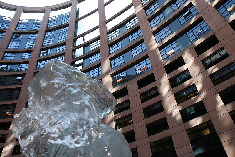 File:Ice sculpture of climate refugee with climate flags on European Parliament (4029201257).jpg