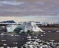 Iceberg with hole around Cape York,Greenland crop.jpg