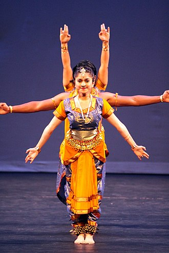 Hindu iconography - In Indian dance, the idea of multiple arms is often shown by several dancers standing behind each other with their arms in different positions.
