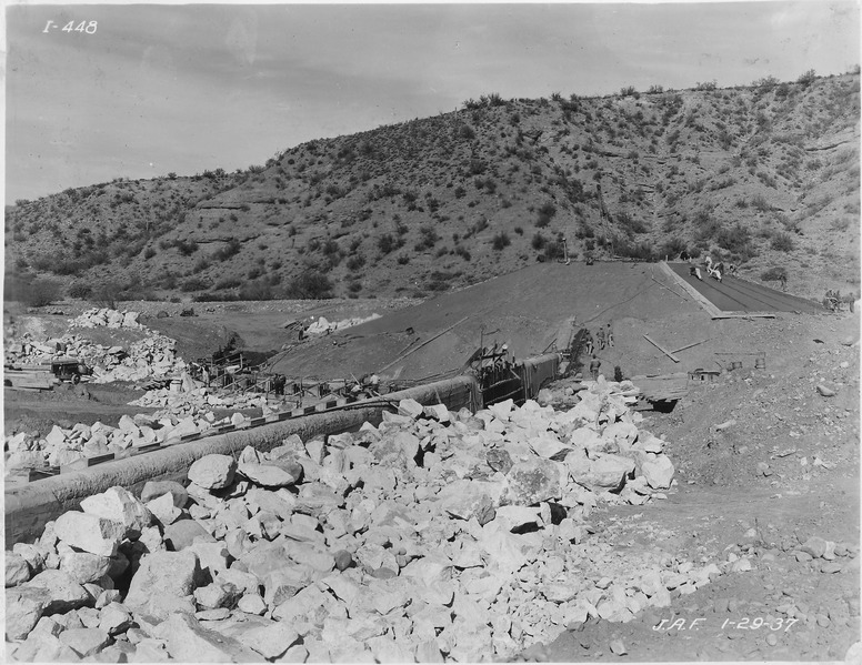 File:Intake diversion dam. View showing rock riprap and nearly completed slope paving on right abutment. Portion of... - NARA - 294584.tiff