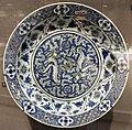 Iran, kerman, piatto a decoro blu e bianco con due draghi, 1600-50 ca..JPG