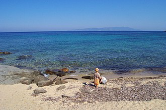 "Isola del Giglio - ""Arenella"" beach with a view of Monte Argentario on the nearby Tuscan coast"