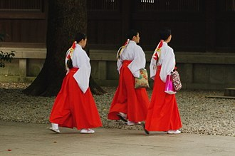 Miko - The miko's attire consists of a white haori and a red hakama. The hair is tied in a ponytail with a white and red hair ribbon.