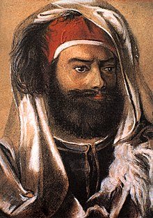 Painting of a bearded Champollion wearing a traditional Egyptian dress.