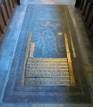 Monumental brass of John Rudying - Full length tomb slab showing the remains of the monumental brass of 1481