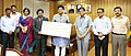 K.S. Popli presenting the dividend cheque to the Minister of State (Independent Charge) for Power, Coal and New and Renewable Energy, Shri Piyush Goyal, in New Delhi. The Secretary, MNRE.jpg