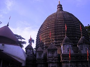 Kamakhya Temple - The shikhara made of bricks ringed by a cluster of angashikhara of Bengal ''charchala'' was an innovation.  The artisans in the 16th-century tried to rebuild the stone shikhara of the original temple unsuccessfully. Part of the antarala is also visible, which is of type atchala.