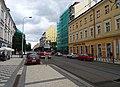 Karlín, Sokolovská 94 a 96, tramvaj vjíždí do zastávky Křižíkova.jpg