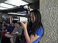 Katie Chan photographing the Crazy Contentious Copyright Challenges Constraining Community Creativity session at Wikimania 2014 01.jpg