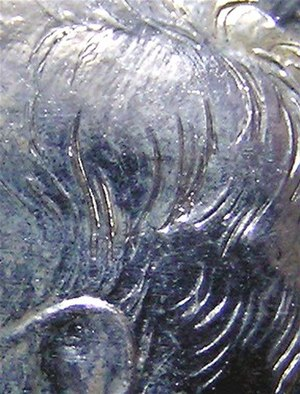 Kennedy half dollar - A close-up image detailing the heavily accented hairlines present on early Kennedy half dollar proof issues