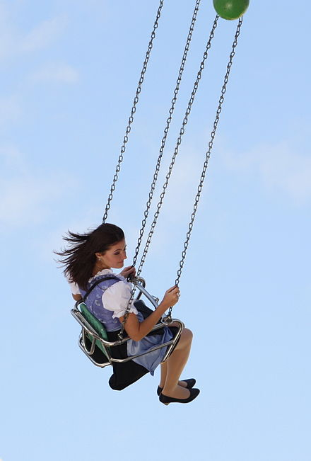 A woman on a swing ride at the Oktoberfest in Munich, Germany.
