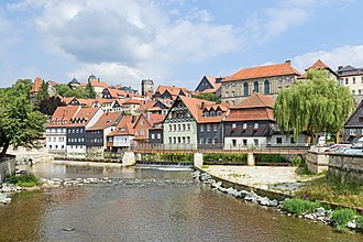 Kronach - Historical town center of Kronach with the river Hasslach in the foreground.
