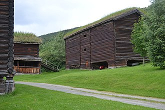 Log house - 17th-century log buildings in Heidal, Norway. Corner of a ″loft″ store-house, a horse stable and a log barn