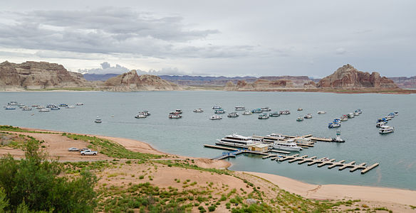 Lake Powell with Marina and rock formations in the background near Page
