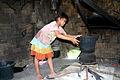 Lao Katang girl steams rice.JPG