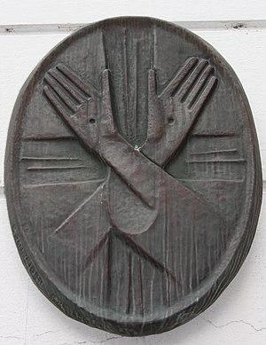 Stigmata - Hands with stigmata, depicted on a Franciscan church in Lienz, Austria
