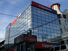 "Corner view of a rectangular building which displays the sign ""Lippo Bank"""