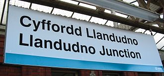 Arriva Trains Wales - A bilingual station sign