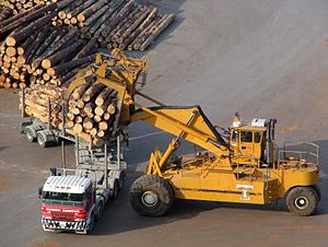 Forestry in New Zealand - A logging truck being unloaded at Port Chalmers