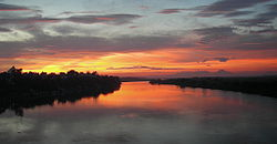 Sunset over Red River, view from Long Bien Bridge, Hanoi, Vietnam