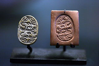 Stamp seal carved object, usually stone, used to impress their carving into soft material such as clay