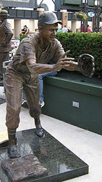 At U.S. Cellular Field, a bronze statue depicts a baseball player stepping on the base and leaning forward to catch a baseball being flipped to him.
