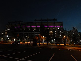 M&T Bank Stadium - North-end view during the Ravens' Super Bowl XLVII run in 2013. The stadium is lighted in purple LED every Ravens postseason.