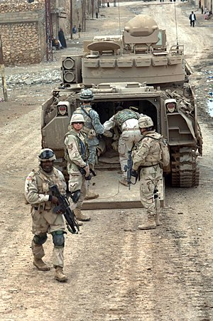Infantry - Infantry of the US 3rd Armored Cavalry Regiment enter their M2 Bradley IFV during a combat patrol, Tall Afar, Iraq, 2006