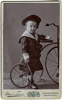 Mai Manó - Boy in a sailor suit with a bicycle c 1895.jpg