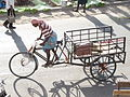 Market porter pedals jugaad goods carrier tricycle in Thoothukudi, Tamil Nadu, India.jpg
