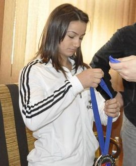 Majlinda Kelmendi, an Olympic, World and European champion. Memli Krasniqi meeting Majlinda Kelmendi (cropped2).JPG
