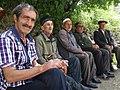 Men on Bench - Village of Kis - Near Sheki - Azerbaijan (18268829135).jpg
