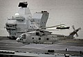 Merlin HM2 of 820 NAS in flight over HMS Queen Elizabeth (R08) on 26 June 2017 (45162796).jpg