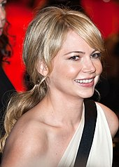 An upper body shot of a smiling Michelle Williams