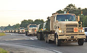 Military trucks laden with ammunition convoy.jpg
