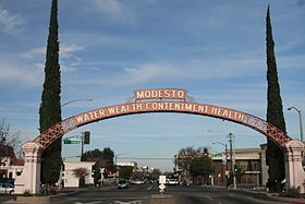 Modesto Arch, including the city motto