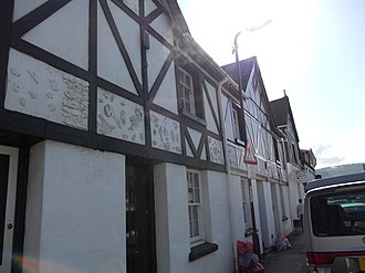 Charles Henry Crompton-Roberts - House walls in Drybridge Street, Monmouth, showing the wooden wallpaper blocks provided as decorative features by Crompton-Roberts