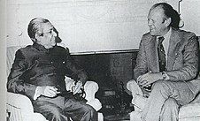 A seated Sheikh Mujibur Rahman and Gerald Ford, smiling and talking
