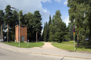 Desire path - A desire path (right) merges with a footpath (center) in Helsinki, Finland