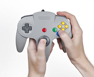 Nintendo 64 controller - Use of the analog stick requires the player to hold the center prong.