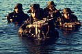 Navy SEALs coming out of water.JPEG