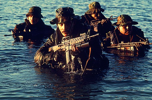 Navy SEALs coming out of water